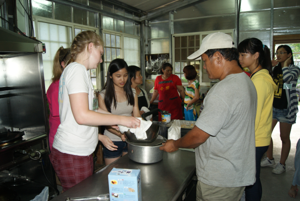 Saint Vincent students and Cardinal Tien students show some villagers how to make jello.
