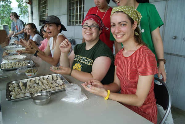 (from left to right) Zack Zuck, Kate Steinel, and Maria Solomond make some delicious organic dumplings.