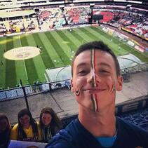 Mickey Orange Soccer Fan in Stadium