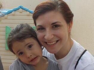 Sara Krug with Children in Brazil